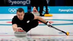 Russian mixed doubles curling medallist denies doping  article image
