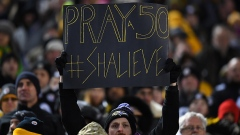 Baltimore Ravens fan holds up a sign honoring Ryan Shazier #50
