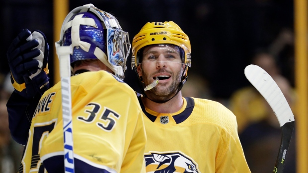 Mike Fisher and Pekka Rinne