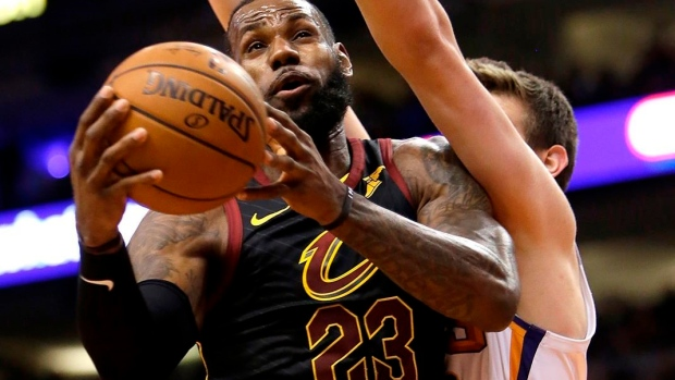 James' triple-double leads Cavaliers past lowly Suns Article Image 0
