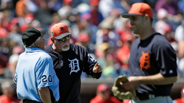 Detroit Tigers manager Ron Gardenhire, center, argues with home plate umpire Tom Hallion