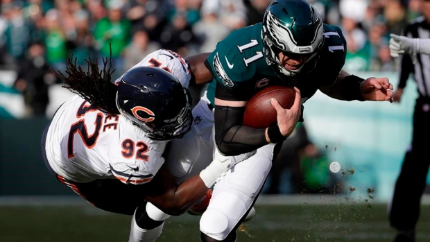 Pernell McPhee tackles Carson Wentz