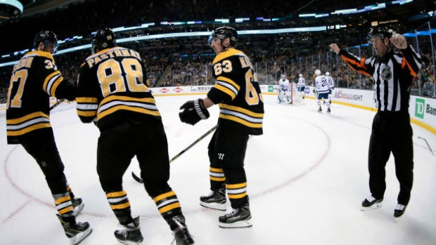 Bergeron, Pastrnak and Marchand celebrate
