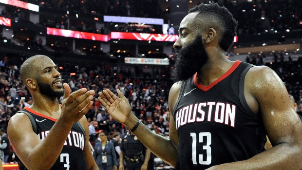 Chris Paul and James Harden celebrate