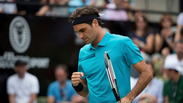 Federer through, Zverev out in Halle