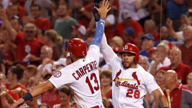 Matt Carpenter and Tommy Pham celebrate
