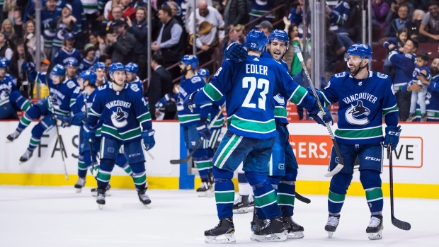 detailed look 3a833 a94d1 Canucks trying to build their brand by taking preseason ...