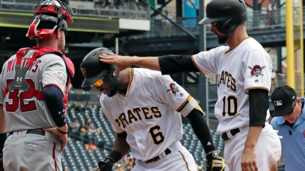 Starling Marte celebrates with Jordy Mercer