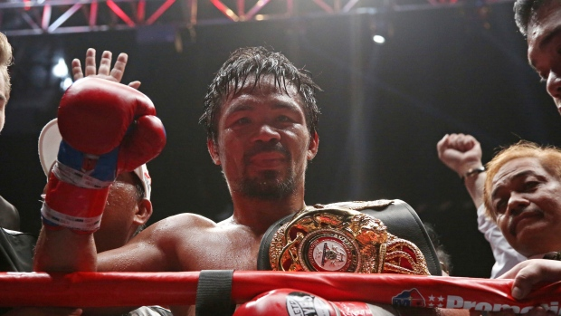 Pacquiao back home after title win against Matthysse