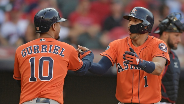 Astros, Dodgers win routs to advance in Major League Baseball playoffs