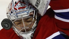 Carey Price takes puck off the mask