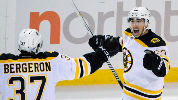 Marchand, Bergeron celebrate