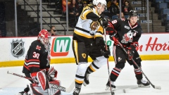 Hamilton Bulldogs forward Matthew Strome screens Stephen Dhillon (Photo by Brandon Taylor)