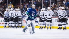 Los Angeles Kings celebrate behind Jacob Markstrom