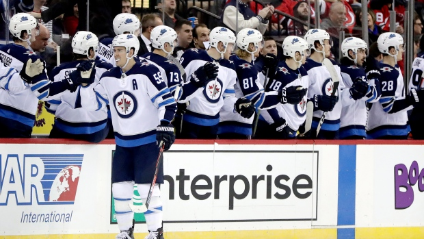 the latest 3488d b75df Scheifele scores OT winner as Jets beat Devils - TSN.ca