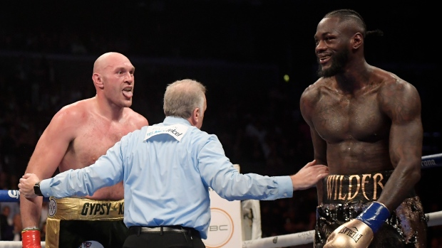 Tyson Fury STOPPED Staples Center riot after Deontay Wilder draw