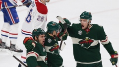 Nino Niederreiter, Zach Parise and Charlie Coyle celebrate vs. Habs