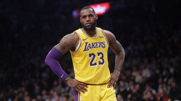 d20fe544 LeBron James , The Canadian Press. Los Angeles Lakers star LeBron James is  gifting new teammate Anthony Davis his No. 23 ...