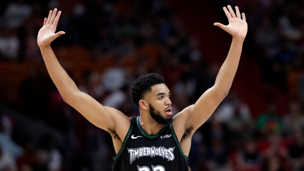 Towns misses 1st game of career after auto accident