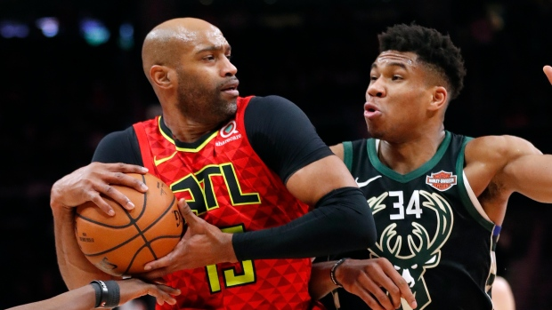 Giannis Antetokounmpo and Vince Carter