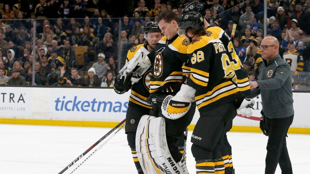 Bruins' Rask leaves game after collision