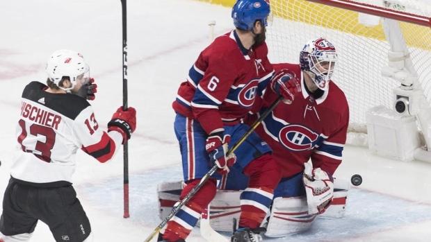 3cc36886a Hischier scores OT winner to lift Devils over Canadiens - TSN.ca