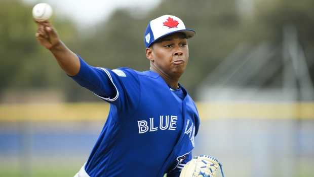 Elvis Luciano pitches during spring training in Dunedin, Fla.