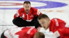 Brad Gushue directs his sweepers
