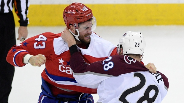Tom Wilson punches Ian Cole during a game on Feb. 7.