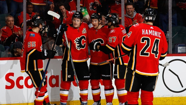 Flames clinch playoff spot with Wild's OT loss