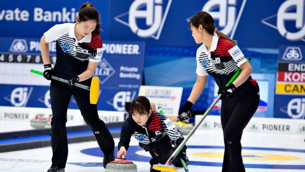 Korean players in action in their World Women's Curling Championship