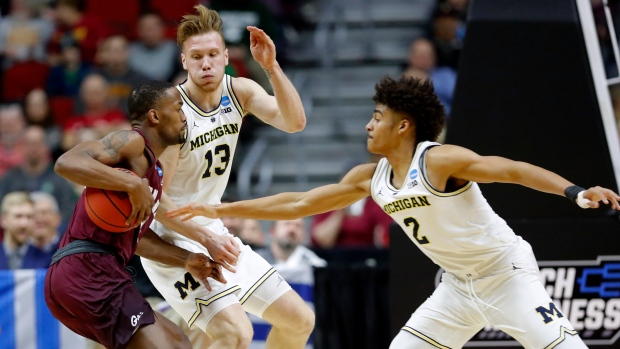 Sayeed Pridgett and Michigan's Ignas Brazdeikis