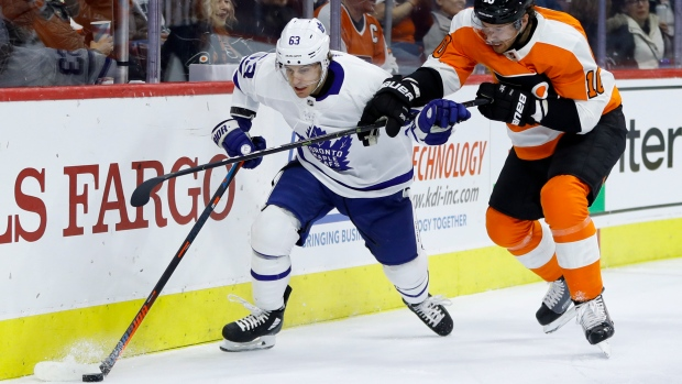 Leafs forward Tyler Ennis battles Flyers' Corban Knight on Wednesday.