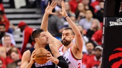 Raptors centre Marc Gasol defends against Magic centre Nikola Vucevic.