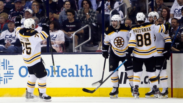 Bruins power past Hurricanes in Game 1