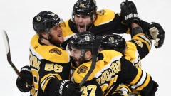 Patrice Bergeron is congratulated by his teammates Thursday.