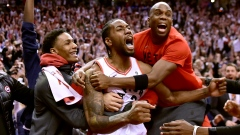Kawhi Leonard celebrates with teammates