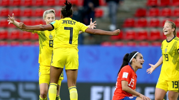 Sweden strike late against Chile after torrential rain stops play