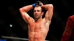 Rockhold (back) says he's out of UFC 268 fight vs. Strickland at