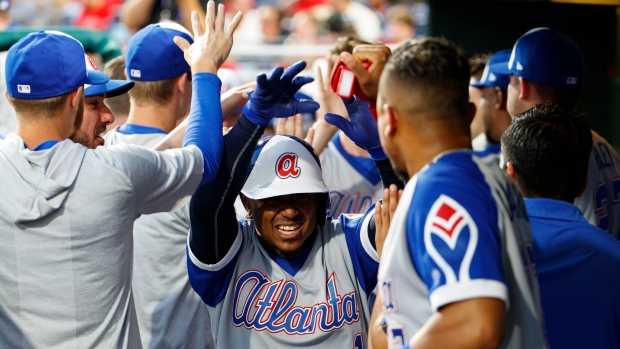 the latest 614c1 666a3 Ozzie Albies hits grand slam, Atlanta Braves rout burgundy ...