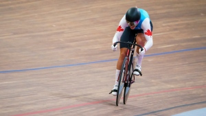 Mitchell sets track cycling record, advances to quarterfinals