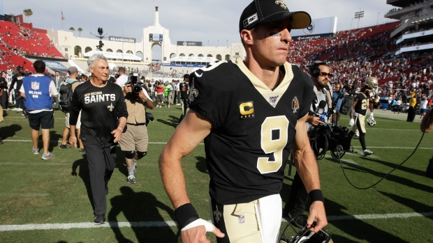 Injured Saints quarterback Drew Brees leaves the field after Sunday's loss to the Rams.