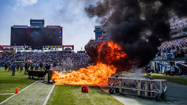 A pyrotechnic accident lights a part of the field on fire before Colts-Titans game