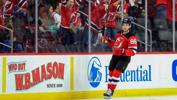 cheap for discount c2a17 d582a Jack Hughes powers New Jersey Devils past New York Rangers ...