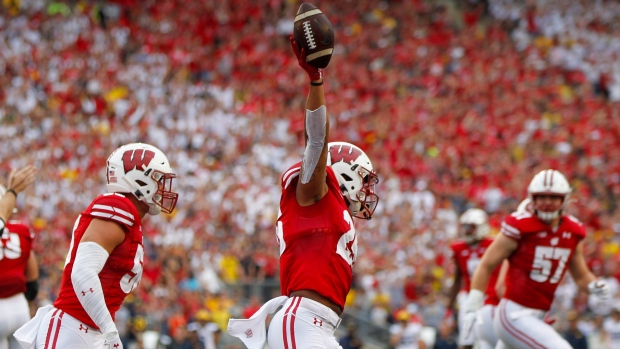 Taylor Helps No. 13 Wisconsin trounce No. 11 Michigan