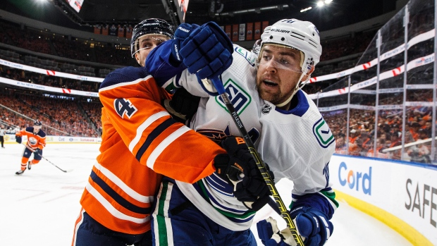 Draisaitl scores twice as Oilers edge Canucks