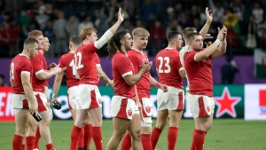 Wales edges Fiji in a thriller to reach quarters