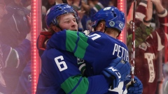 Brock Boeser (6) celebrates his goal with teammate Elias Pettersson