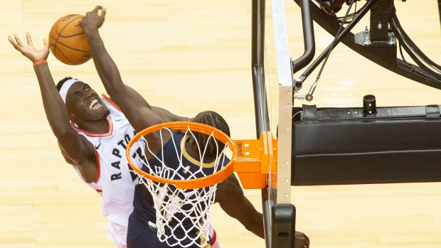 Pascal Siakam shoots over Pelicans' Jrue Holiday Tuesday night.