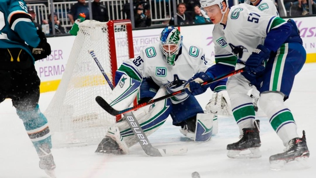 Sharks beat Canucks 4-2 to snap 6-game skid